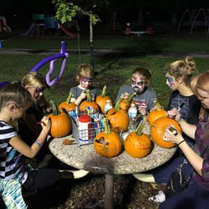 Families enjoying Orchard's fall party