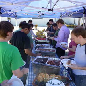 Orchard team enjoying food at an event